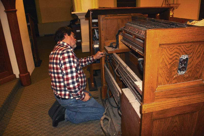 Jack Haase works on the pipe organ