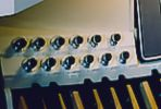 Knobs normally located directly above the pedal keyboard that can be pressed with the feet, to activate reversibles or combination pistons.